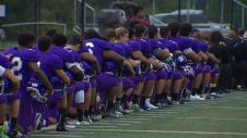 Garfield High School in Students at Seattle kneeling during the national anthem